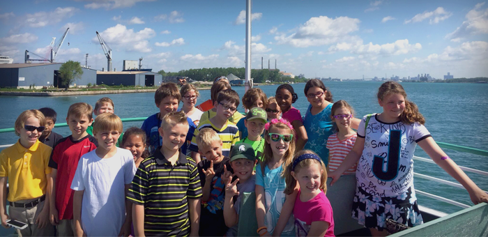Students on a cruise ship enjoying their Diamond Jack Detroit River tour field trip.