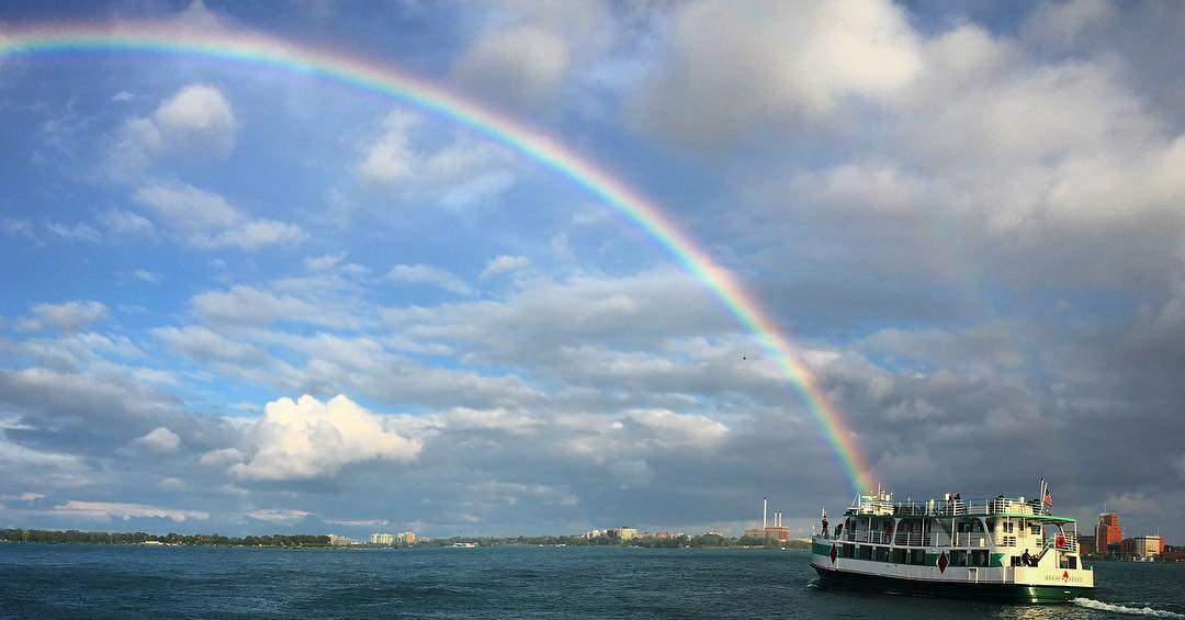Diamond Jack River Boat on Detroit River with rainbow in background