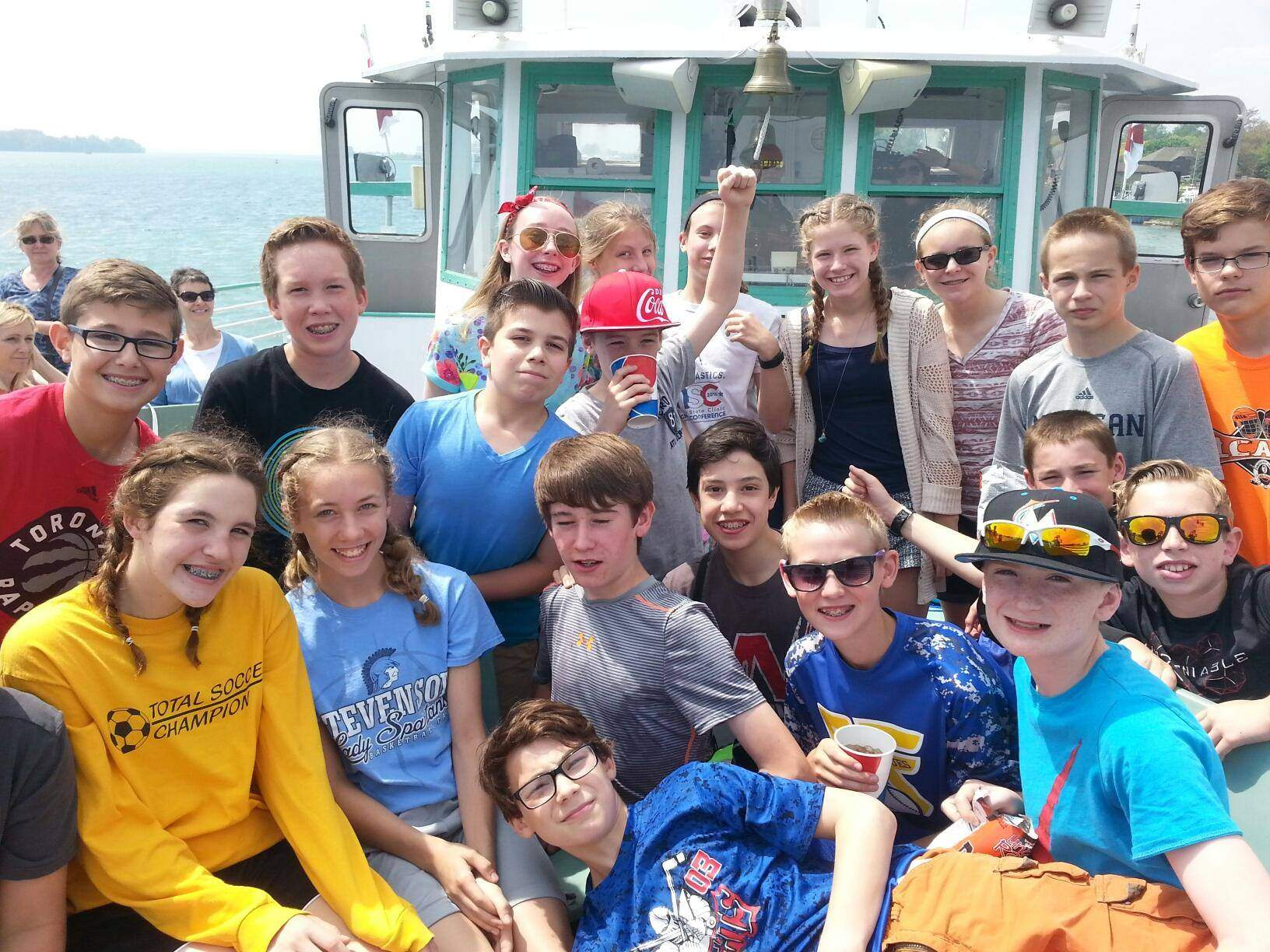 Middle school students on a river boat field trip