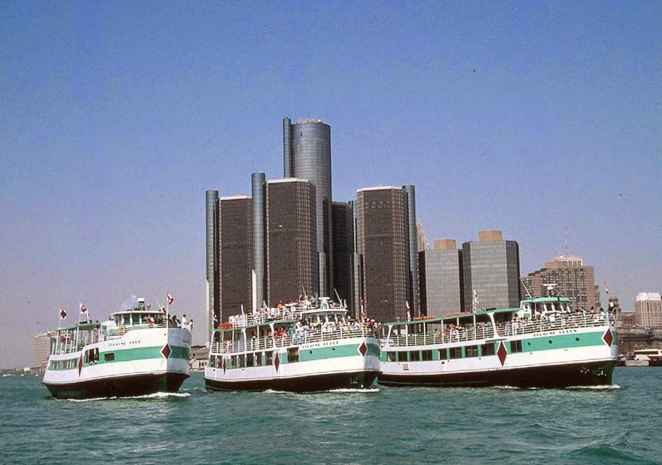 Diamond Jack boats on river in front of Renaissance Center